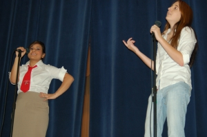 "Drama students Bianca Garcia and Erika Davis perform the play ""Accused of Comedy"" for the West Elementary."